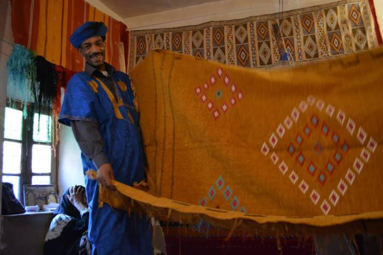 One of the happiest people I have met was a carpet craftsman in Morocco.